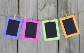 Colorful frames hanging on clothesline