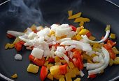 Peppers and Onions Frying In Skillet