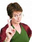 Bossy looking middle-aged woman wagging her finger in disapproval.  Isolated on white.