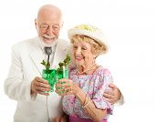 Southern senior couple enjoying traditional mint julep coctails to celebrate the Kentucky Derby.  Is