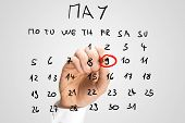 stock photo of nazi  - Man marking Victory Day 9th May commemorating the capitulation of Nazi Germany to the Soviet Union in the Second World War on a handwritten calendar on a virtual interface - JPG
