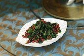 Appetizer Of Wilted Spinach With Peanuts