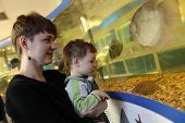 Mom With Son At Oceanarium