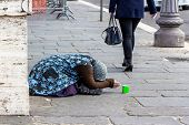 picture of beggars  - a beggar begging on a street in the - JPG