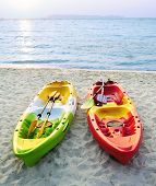 Canoes On The Beach.