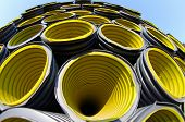 Yellow Corrugated Pipes In A Roadworks For Laying Optical Fiber