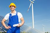 Engineer Posing With Wind Turbine And Solar Panels