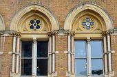 Arched victorian brick windows