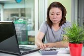 Beautiful Asian Woman Using Laptop Computer