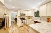 Refreshing Kitchen Interior With White Cabinets.