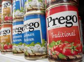 Cans of Prego pasta sauce