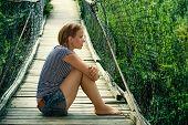 Lonely girl on the bridge
