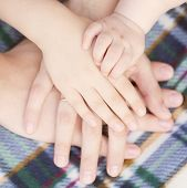 Four Hands Of The Family Together.