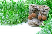 Green tinsel with snow boots decoration