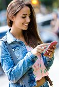 Smiling Beautiful Woman Texting With Her Phone