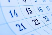 stock photo of oblique  - Oblique view of a blank calendar with selective focus to the dates for the 15th and 22nd of the month conceptual of organization setting a reminder and scheduling