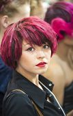 Portrait of beautiful woman with red hair at the hair fashion show