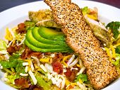 Fresh Southwestern Style Salad With Avocado Slices And Seeded Cracker
