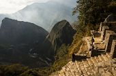 People Seeing The Sunset From The Intipunko In Machu Picchu