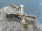 Wooden Cross In The Mountains With Jesus Body, Against Dramatic Sky