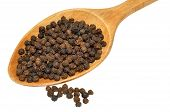 Black Peppercorns And Wooden Spoon