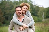 Smiling Couple Having Fun With Piggyback Ride
