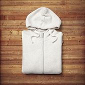 White Hoodie On Wood Background