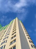 New colorful green building, blue sky