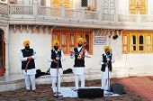 Indian Musicians Playing Local Instruments In Golden Temple In Amritsar. India