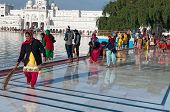 Indian Women Clean Floor Near Golden Temple Before The Evening Prayer. Amritsar