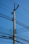 picture of utility pole  - Poles filled with various kinds of wires - JPG