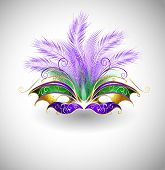 stock photo of feathers  - bright mask with purple and green feathers decorated with gold pattern on a light background - JPG