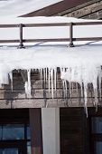 Icicles and snow on the roof of a house