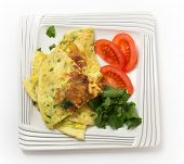 Homemade potato and parmesan cheese frittata omelet, with tomato and rocket, from an Italian recipe, from above