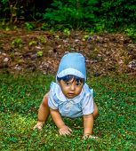 Latino Baby Crawling In The Crass