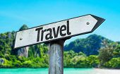 Travel sign with a beach on background