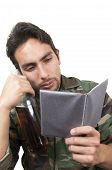 picture of veterans  - distraught military soldier veteran ptsd holding a bottle and looking at photos isolated on white - JPG