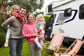 stock photo of camper-van  - Family Enjoying Camping Holiday In Camper Van  - JPG