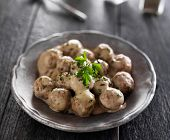swedish meatballs with parlsey on gray slate