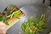 stock photo of chinese wok  - Sauteing or stir frying the japanese spinach in chinese style - JPG