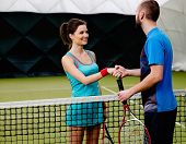 Woman tennis player shaking hand with her coach