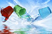 foto of bucket  - three colorful buckets with water against blue sky - JPG