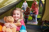 foto of teddy  - Girl With Teddy Bear Enjoying Camping Holiday On Campsite  - JPG