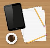 Desk concept with a blank paper, a cup of coffee and a modern tablet with space for text.