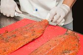 Chef Cutting Salmon Fish