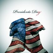 the text Presidents Day and man clasped hands patterned with the flag of the United States