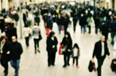 foto of pedestrians  - defocused blur background of people walking in a pedestrian street  - JPG