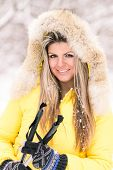 Blonde Young Smiling Woman With Ski At Winter Time