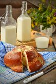 Bun With Butter And Milk. Breakfast In Rustic Style. Selective Focus