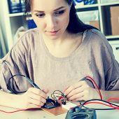 girl using a multimeter